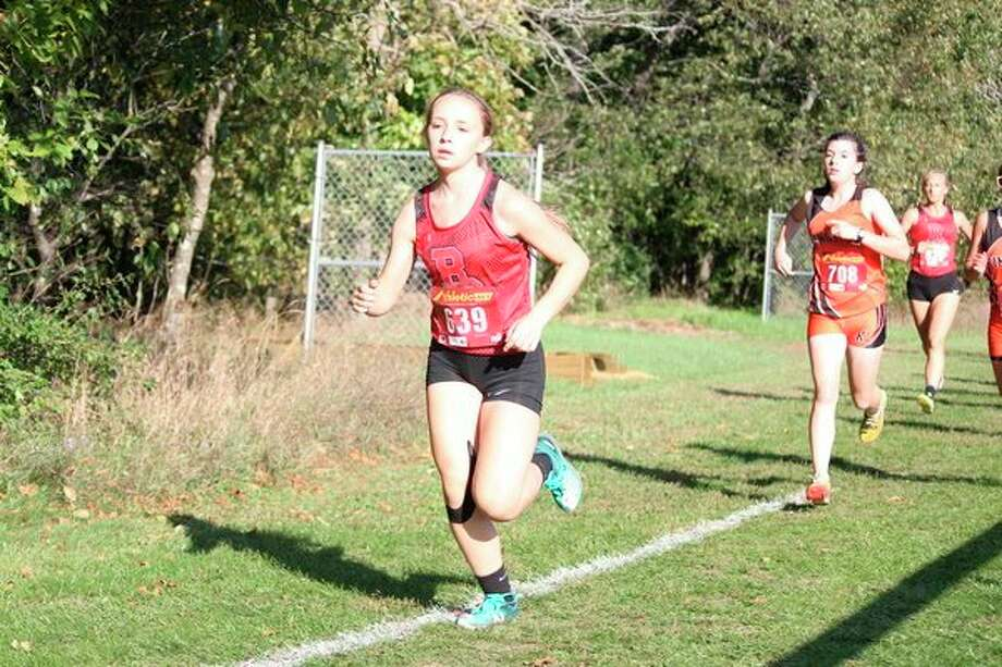 Benzie Central's Madison Teichman races in a conference race earlier this fall. (File photo)