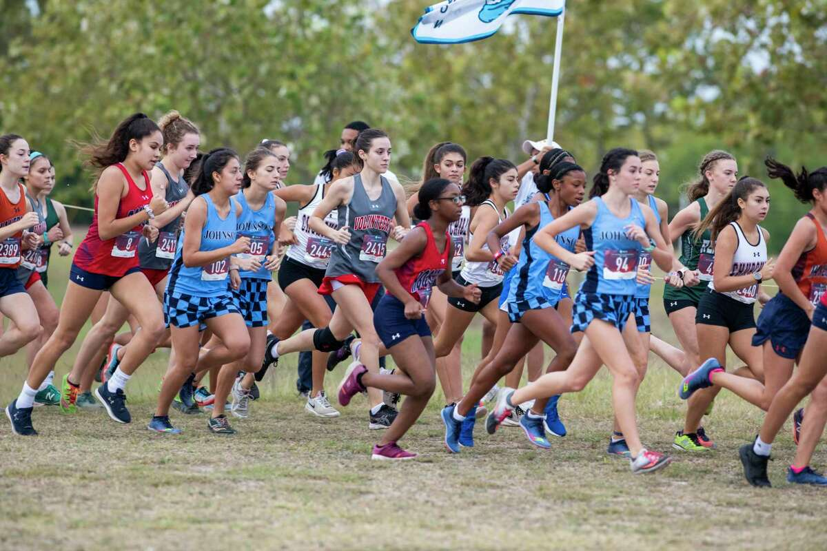 Lee High School's Raquel Moore, center, competes along with other area athletes during the District 27-6A cross country championship on Saturday, Oct. 19, 2019.