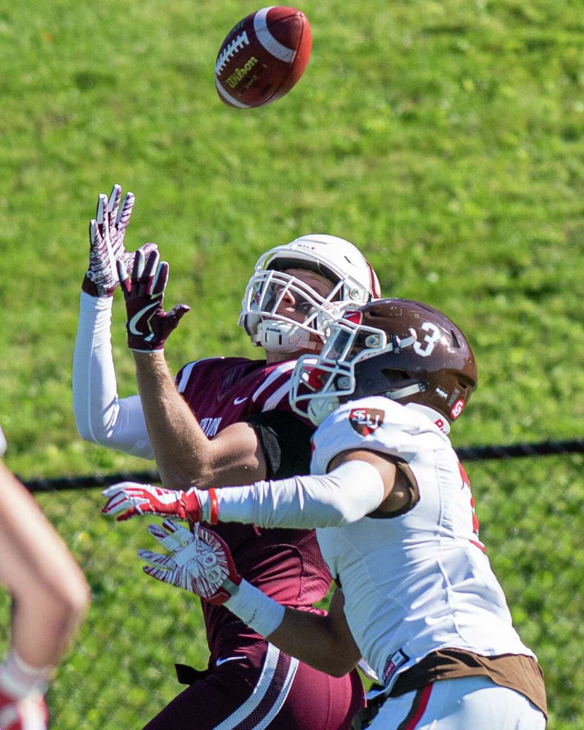 Union College receiver Will Sirmon makes a catch in front of St. Lawrence defensive back Rahmod Johnson during a game at Union College on Saturday, Oct. 19, 2019 (Jim Franco/Special to the Times Union.)
