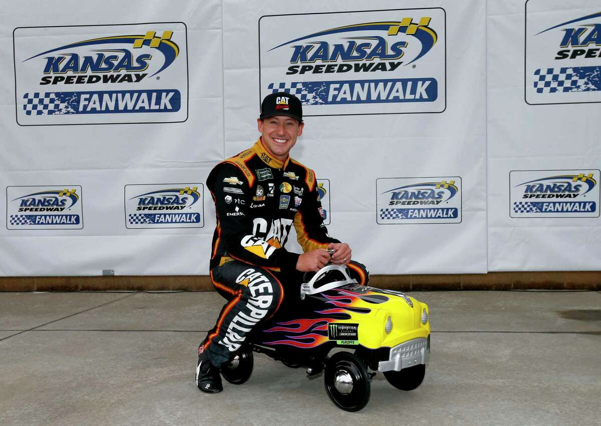 KANSAS CITY, KANSAS - OCTOBER 19: Daniel Hemric, driver of the #8 Caterpillar Chevrolet, poses with a pole award pedal car after qualifying for the Monster Energy NASCAR Cup Series Hollywood Casino 400 at Kansas Speedway on October 19, 2019 in Kansas City, Kansas. (Photo by Jonathan Ferrey/Getty Images)