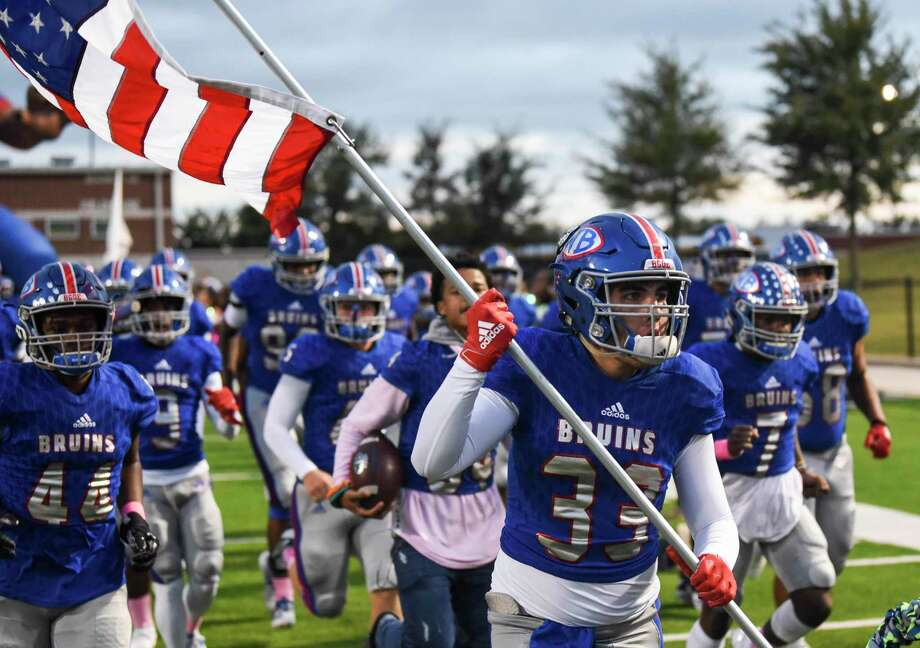 West Brook players run onto the field before the game at BISD's Memorial Stadium Friday night. Photo taken on Friday, 10/11/19. Ryan Welch/The Enterprise Photo: Ryan Welch, Beaumont Enterprise / The Enterprise / © 2019 Beaumont Enterprise