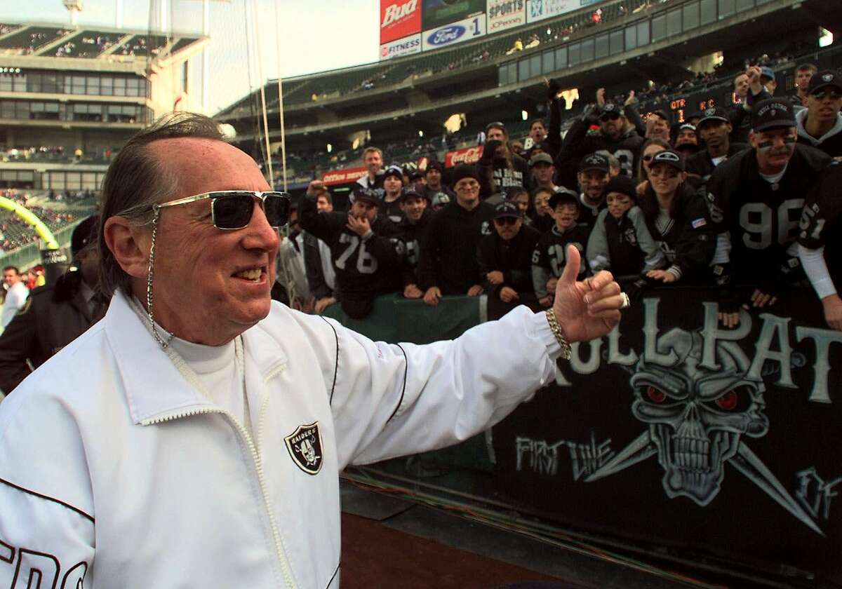 Oakland Raiders owner Al Davis gives a thumbs-up to fans prior to the game with the Kansas City Chiefs on Saturday, Dec. 26, 1998, in Oakland, Calif. (AP Photo/Paul Sakuma)
