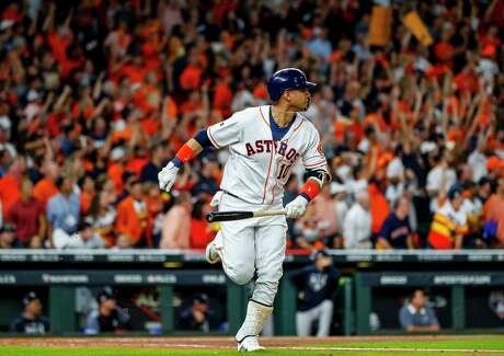 Houston Astros first baseman Yuli Gurriel (10) hits a three-run home run during the first inning of Game 6 of the American League Championship Series at Minute Maid Park in Houston on Saturday, Oct. 19, 2019.