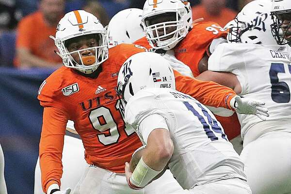 Roadrunner defensive end Jarrod Carter-McLin moves in to capture Owls quarterback Tom Stewart as UTSA hosts Rice at the Alamodome on Oct. 19, 2019.
