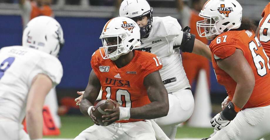 Roadrunner quarterback Lowell Narcisse cuts away from pursuit as UTSA  hosts Rice at the Alamodome on Oct. 19, 2019. Photo: Tom Reel/Staff Photographer
