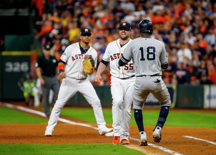 Houston Astros relief pitcher Ryan Pressly (55) tags out New York Yankees shortstop Didi Gregorius (18) to end the top of the third inning of Game 6 of the American League Championship Series at Minute Maid Park in Houston on Saturday, Oct. 19, 2019.
