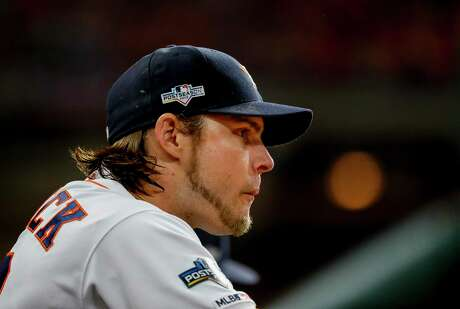Houston Astros right fielder Josh Reddick (22) watches from the dugout during Game 6 of the American League Championship Series at Minute Maid Park in Houston on Saturday, Oct. 19, 2019.