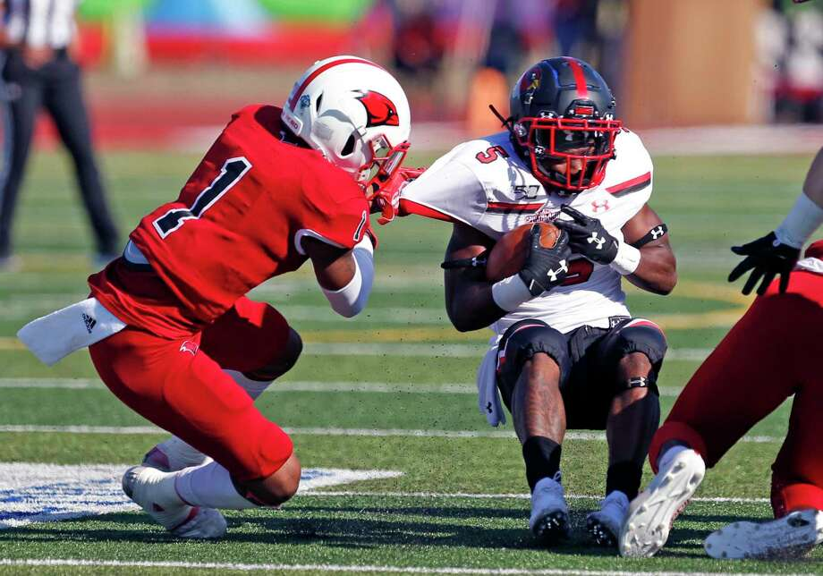 UIW Jaylen Jimmerson hangs onto Lamar running back Myles Wanza on Friday, October 19, 2019 at University of Incarnate Word. Photo: Ronald Cortes/Contributor / 2019 Ronald Cortes