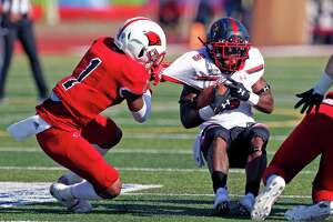 UIW Jaylen Jimmerson hangs onto Lamar running back Myles Wanza on Friday, October 19, 2019 at University of Incarnate Word.