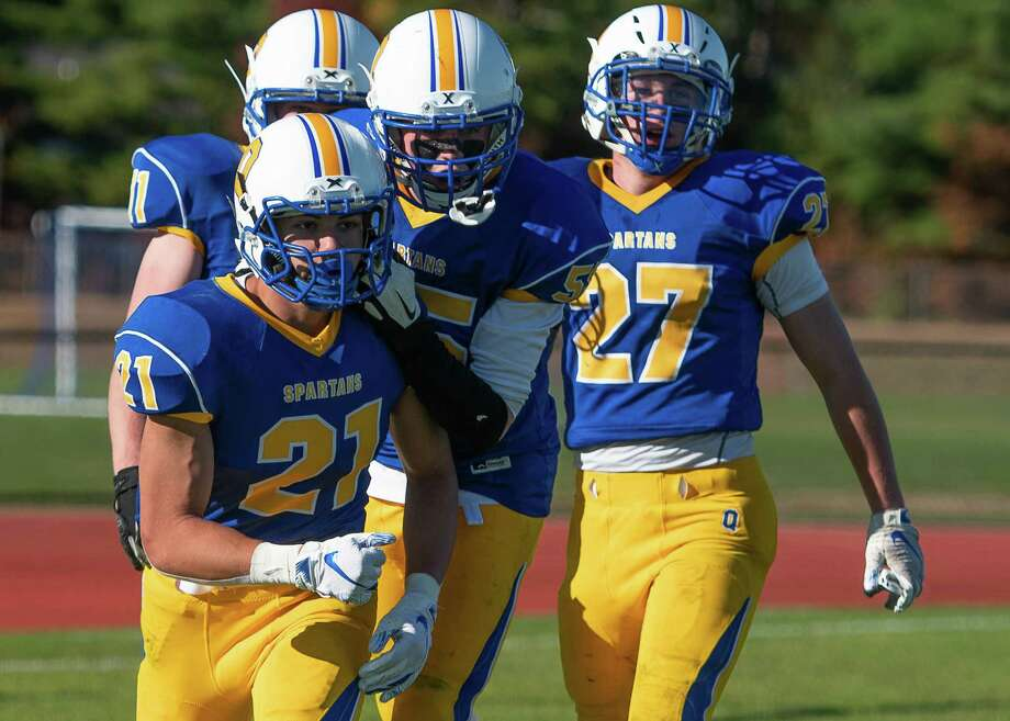 Queensbury football players congratulate Jason Rodriguez (21) for a touchdown during the Class A Grasso Division title against Burnt Hills on Saturday, Oct. 19, 2019, in Queensbury, N.Y. (Jenn March, Special to the Times Union ) Photo: Jenn March / © Jenn March 2018 © Albany Times Union 2018