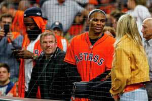Houston Rockets guard James Harden, owner Tilman Fertitta and guard Russell Westbrook talk with Kate Upton from the seats behind home plate during Game 6 of the American League Championship Series at Minute Maid Park in Houston on Saturday, Oct. 19, 2019.