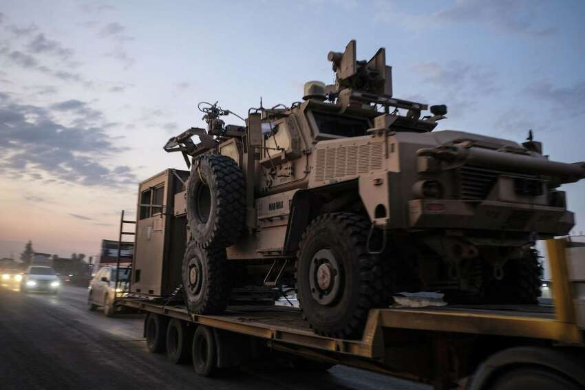SHEIKHAN, IRAQ - OCTOBER 19: A convoy of U.S. armored military vehicles leave Syria on a road to Iraq on October 19, 2019 in Sheikhan, Iraq. Refugees fleeing the Turkish incursion into Syria arrived in Northern Iraq since the conflict began, with many saying they paid to be smuggled through the Syrian border. (Photo by Byron Smith/Getty Images)