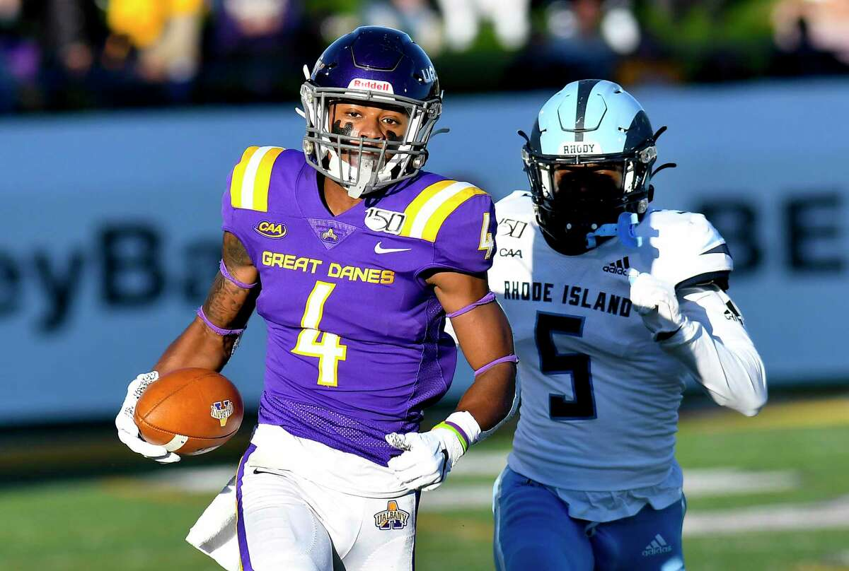 University at Albany wide receiver Juwan Green (4) runs with the ball for touchdown after catching a pass from quarterback Jeff Undercuffler while being defended by Rhode Island defensive back Malik Wilder (5) during the first half of an NCAA football game Saturday, Oct. 19, 2019, in Albany, N.Y.