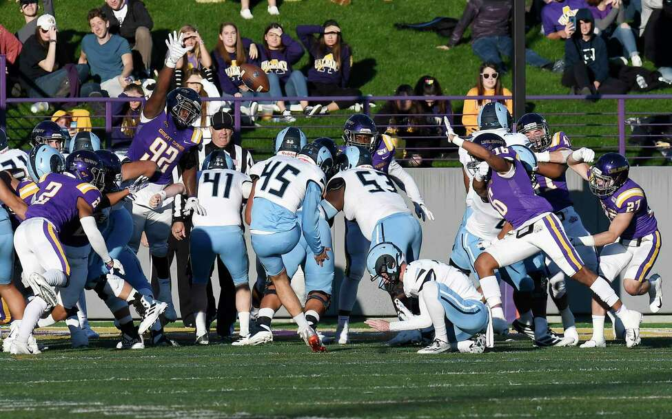 University at Albany defensive lineman Mazon Walker (92) attempts to block a extra point attempt by Rhode Island place kicker C.J. Carrick (45) during the first half of an NCAA football game Saturday, Oct. 19, 2019, in Albany, N.Y.