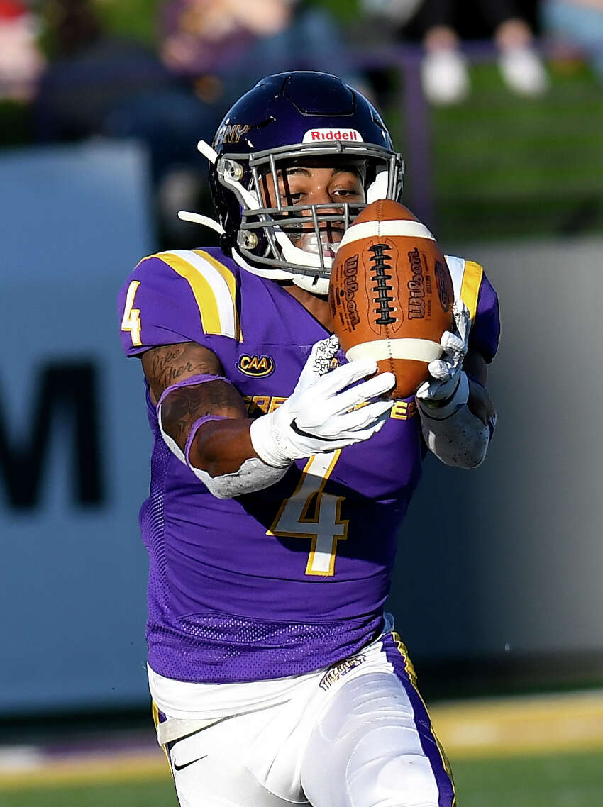 University at Albany wide receiver Juwan Green (4) catches pass from quarterback Jeff Undercuffler for a touchdown against Rhode Island during the first half of an NCAA football game a quarterback Jeff Undercuffler (18) throws a Saturday, Oct. 19, 2019, in Albany, N.Y.