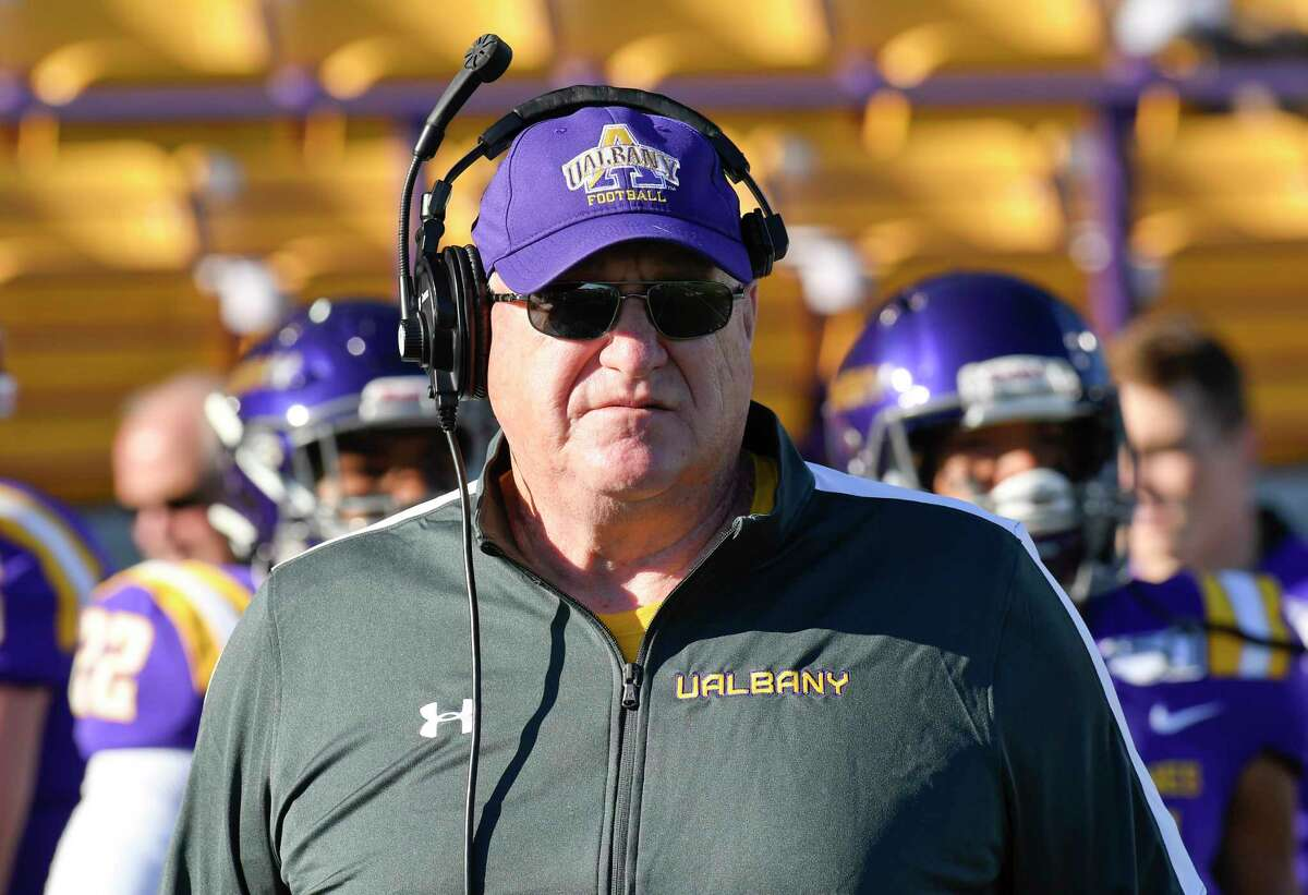 University at Albany head coach Greg Gattuso coaches against Rhode Island during the first half of an NCAA football game Saturday, Oct. 19, 2019, in Albany, N.Y.