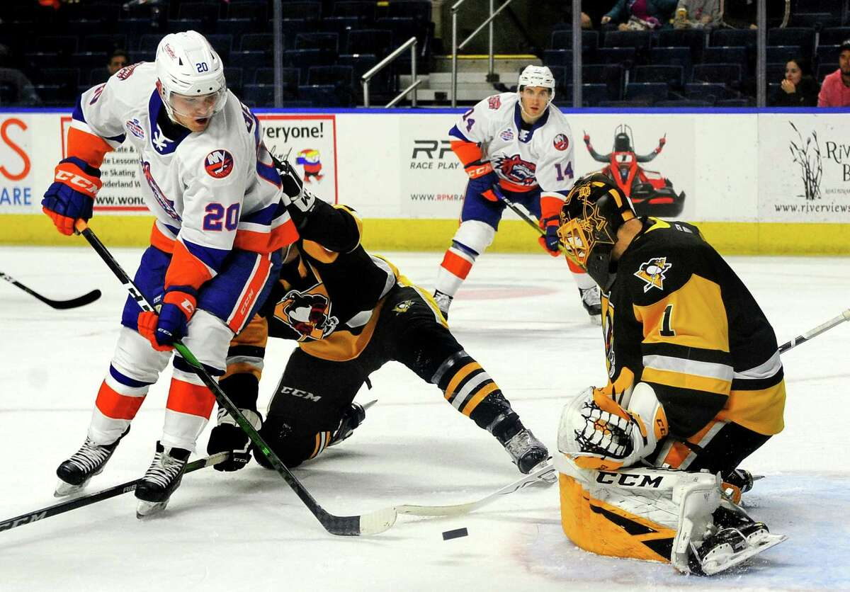 Sound Tigers' Kieffer Bellows (20), left, tries to line up a goal as W-B/Scranton goalie Casey DeSmith blocks during AHL hockey action at the Webster Bank Arena in Bridgeport, Conn., on Satuday Oct. 19, 2019.