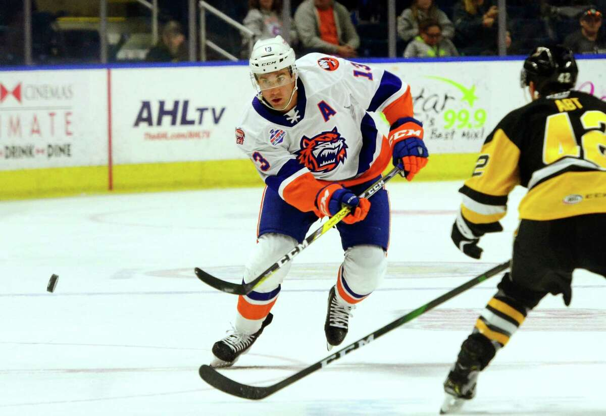 Sound Tigers' Colin McDonald (13) passes the puck during AHL hockey action against W-B/Scranton Penguins at the Webster Bank Arena in Bridgeport, Conn., on Satuday Oct. 19, 2019.