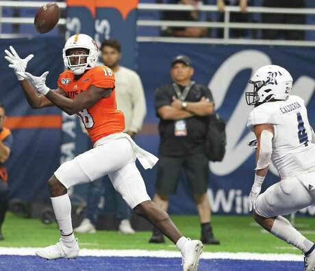 Roadrunner receiver Zakhari Franklin watches the ball as he catches the winning touchdown pass in the end zone as UTSA hosts Rice at the Alamodome on Oct. 19, 2019.