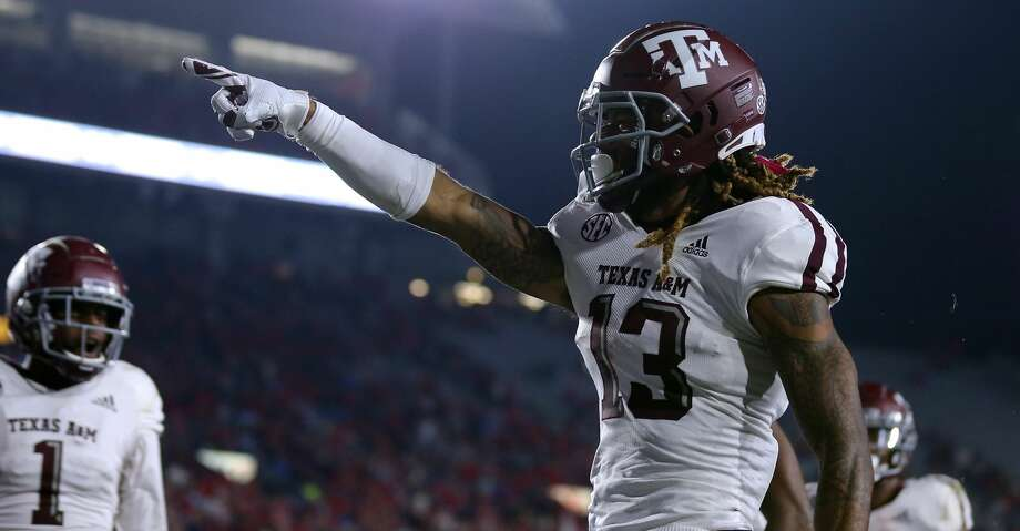 OXFORD, MISSISSIPPI - OCTOBER 19: Kendrick Rogers #13 of the Texas A&M Aggies celebrates a touchdown during the first half against the Mississippi Rebels at Vaught-Hemingway Stadium on October 19, 2019 in Oxford, Mississippi. (Photo by Jonathan Bachman/Getty Images) Photo: Jonathan Bachman/Getty Images