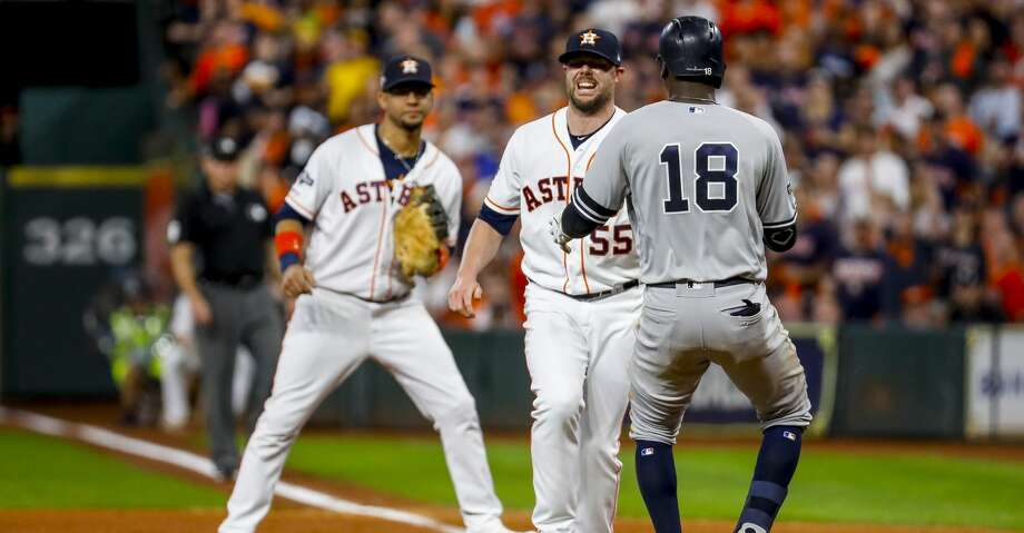 Houston Astros relief pitcher Ryan Pressly (55) tags out New York Yankees shortstop Didi Gregorius (18) to end the top of the third inning of Game 6 of the American League Championship Series at Minute Maid Park in Houston on Saturday, Oct. 19, 2019. Photo: Brett Coomer/Staff Photographer