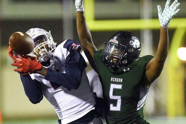 Roosevelt receiver Daqwon Kindred is unable to hold on to the ball as defender LaMarq Patterson of Reagan defends during high school football action against Reagan at Comalander Stadium on Saturday, Oct. 19, 2019.