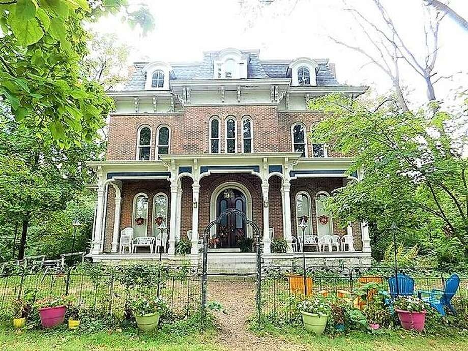 """The McPike Mansion is just one of the reasons Alton is considered one of the most haunted cities in America. Built in 1869, by architect Lucas Pfeiffenberger, the building's original owner, Henry Guest McPike (1825-1910), was a horticulturist, who perfected the """"McPike grape."""" The McPikes lived here until 1936. The home has been featured on several television shows, including """"Scariest Places on Earth."""" Photo: File Photo"""
