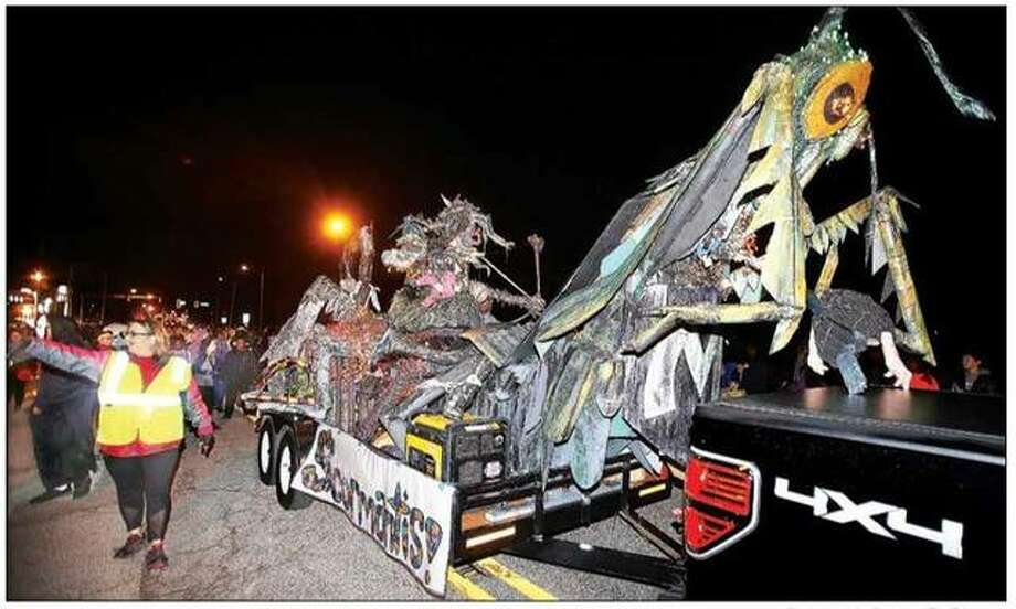 "The Alton Middle School art class' beast — ""The Scormantis,"" half scorpion and half praying mantis — moved through the annual Alton Halloween Parade last year. This year's event is planned for 7 p.m. on Thursday, Oct. 31."