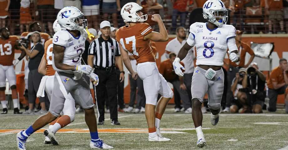 Texas' Cameron Dicker (17) celebrates his winning field goal as Kansas' Kwamie Lassiter II (8) and Elmore Hempstead Jr. (3) watch during the second half of an NCAA college football game in Austin, Texas, Saturday, Oct. 19, 2019. (AP Photo/Chuck Burton) Photo: Chuck Burton/Associated Press
