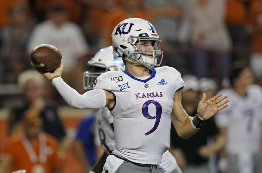 Kansas' Carter Stanley throws a pass during the second half of the team's NCAA college football game against Texas in Austin, Texas, Saturday, Oct. 19, 2019. (AP Photo/Chuck Burton)