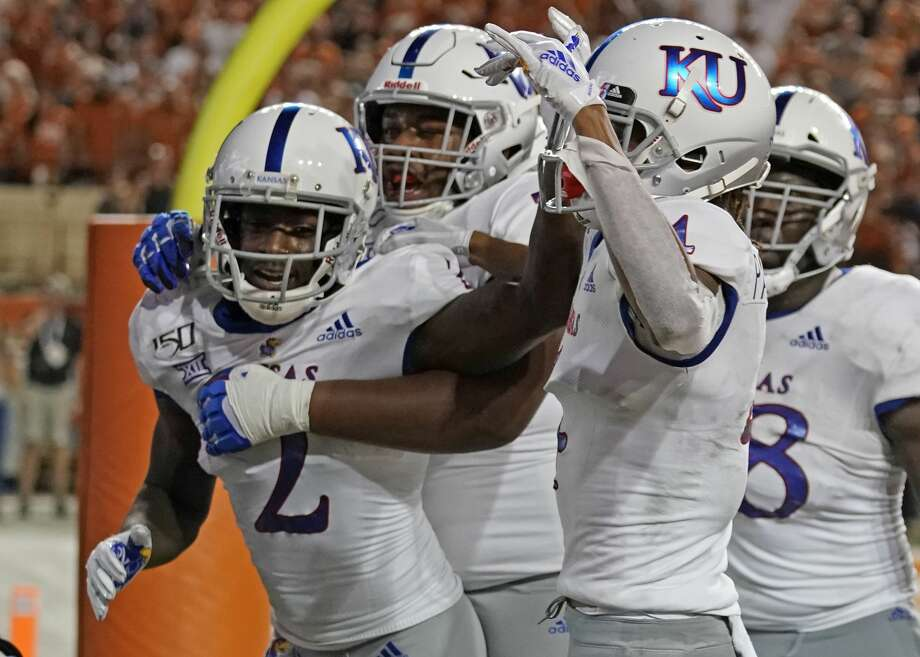 Kansas' Daylon Charlot (2) celebrates with teammates after catching a 2-point conversion during the second half of the team's NCAA college football game against Texas in Austin, Texas, Saturday, Oct. 19, 2019. (AP Photo/Chuck Burton) Photo: Chuck Burton/Associated Press