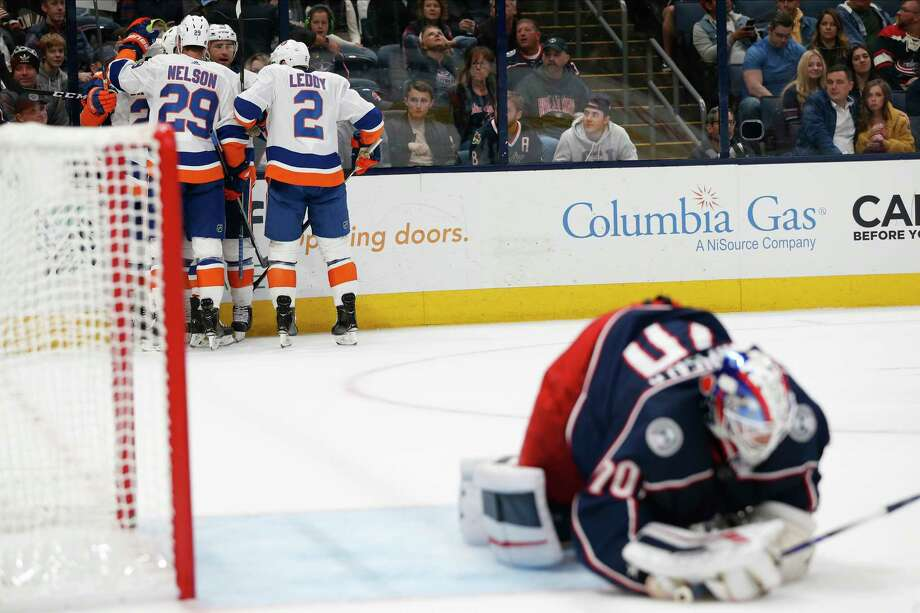 New York Islanders players celebrate their goal against Columbus Blue Jackets' Joonas Korpisalo, of Finland, during the first period of an NHL hockey game Saturday, Oct. 19, 2019, in Columbus, Ohio. (AP Photo/Jay LaPrete) Photo: Jay LaPrete / Copyright 2019 The Associated Press. All rights reserved