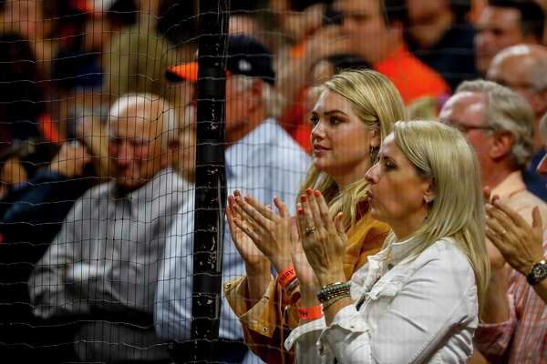 Kate Upton cheers from her seat behind home plate during the ninth inning of Game 6 of the American League Championship Series at Minute Maid Park in Houston on Saturday, Oct. 19, 2019.