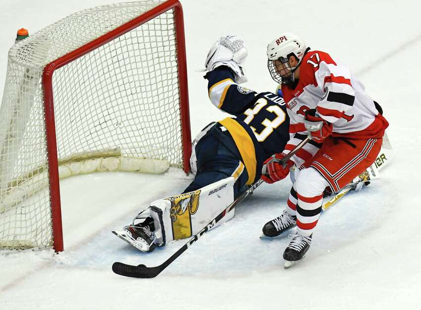 Rensselaer Polytechnic Institute forward Todd Burgess (17) scores against Canisius goaltender Matt Ladd (33) during the first period of an NCAA college hockey game Saturday, Oct. 19, 2019, in Troy, N.Y. (Hans Pennink / Special to the Times Union)