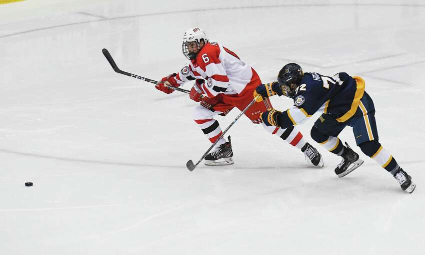 Rensselaer Polytechnic Institute defenseman Brady Ferner (6) and Canisius forward Matt Hoover (72) chase the puck during the first period of an NCAA college hockey game Saturday, Oct. 19, 2019, in Troy, N.Y. (Hans Pennink / Special to the Times Union)