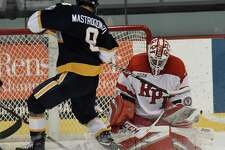 Rensselaer Polytechnic Institute goaltender Owen Savory (31) makes a save against Canisius right wing Keaton Mastrodonato (8) during the second period of an NCAA college hockey game Saturday, Oct. 19, 2019, in Troy, N.Y. (Hans Pennink / Special to the Times Union)