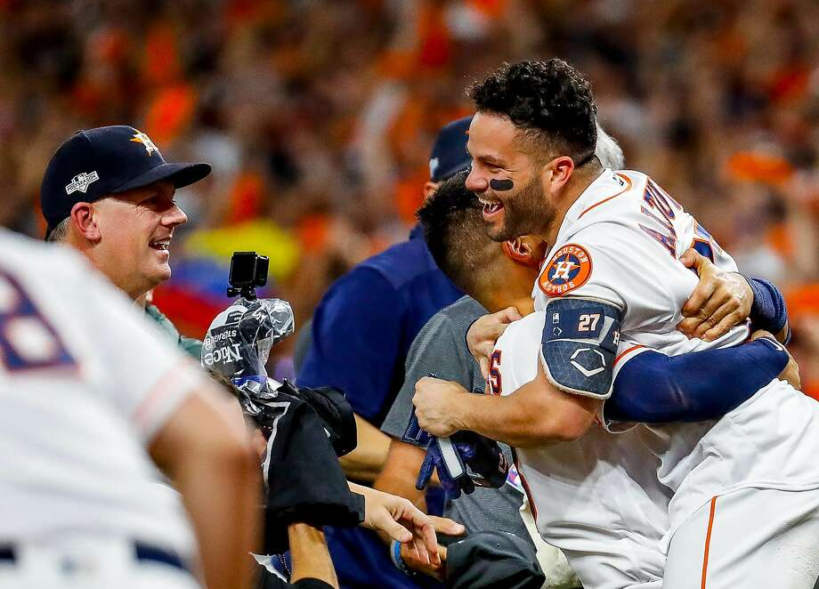 Houston Astros second baseman Jose Altuve (27) is picked up at home plate after hitting a game-winning, two-run, walk-off home run to win Game 6 of the American League Championship Series in the ninth. Photo: Brett Coomer / Houston Chronicle