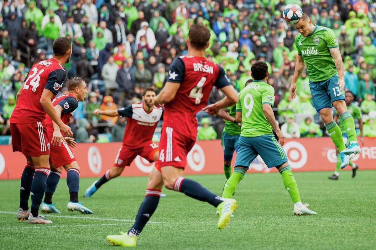 Seattle Sounders forward Jordan Morris (13) misses a header on goal the first half of round one of a MLS Cup playoff soccer game against FC Dallas, Saturday, Oct. 19, 2019 in Seattle. Saturday, Oct. 19, 2019 in Seattle. (Andy Bao/The Seattle Times via AP)