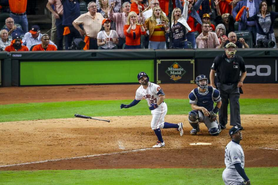 Houston Astros second baseman Jose Altuve (27) hits a game-winning, two-run, walk-off home run to win Game 6 of the American League Championship Series in the ninth inning at Minute Maid Park in Houston on Saturday, Oct. 19, 2019.