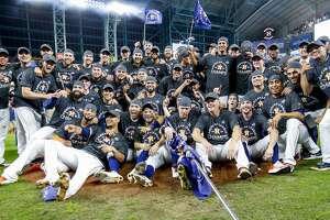 The Houston Astros celebrate after winning Game 6 of the American League Championship Series at Minute Maid Park in Houston on Saturday, Oct. 19, 2019.