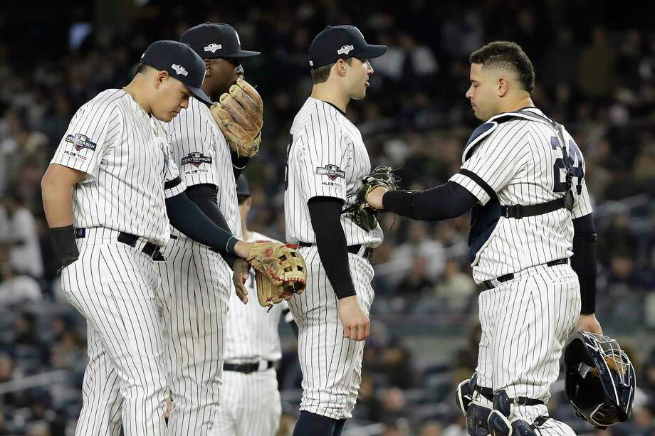 New York Yankees relief pitcher Tommy Kahnle, second from right, waits to be relieved during the seventh inning of Game 5 of baseball's American League Championship Series against the Houston Astros, Friday, Oct. 18, 2019, in New York. (AP Photo/Frank Franklin II) Photo: Frank Franklin II / Copyright 2019 The Associated Press. All rights reserved.