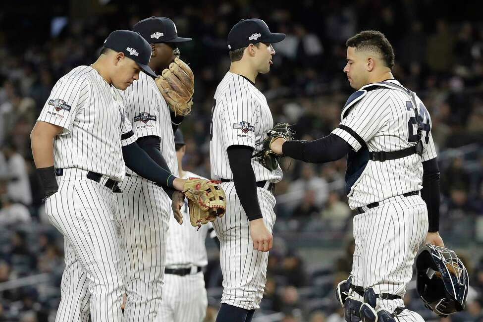New York Yankees relief pitcher Tommy Kahnle, second from right, waits to be relieved during the seventh inning of Game 5 of baseball's American League Championship Series against the Houston Astros, Friday, Oct. 18, 2019, in New York. (AP Photo/Frank Franklin II)