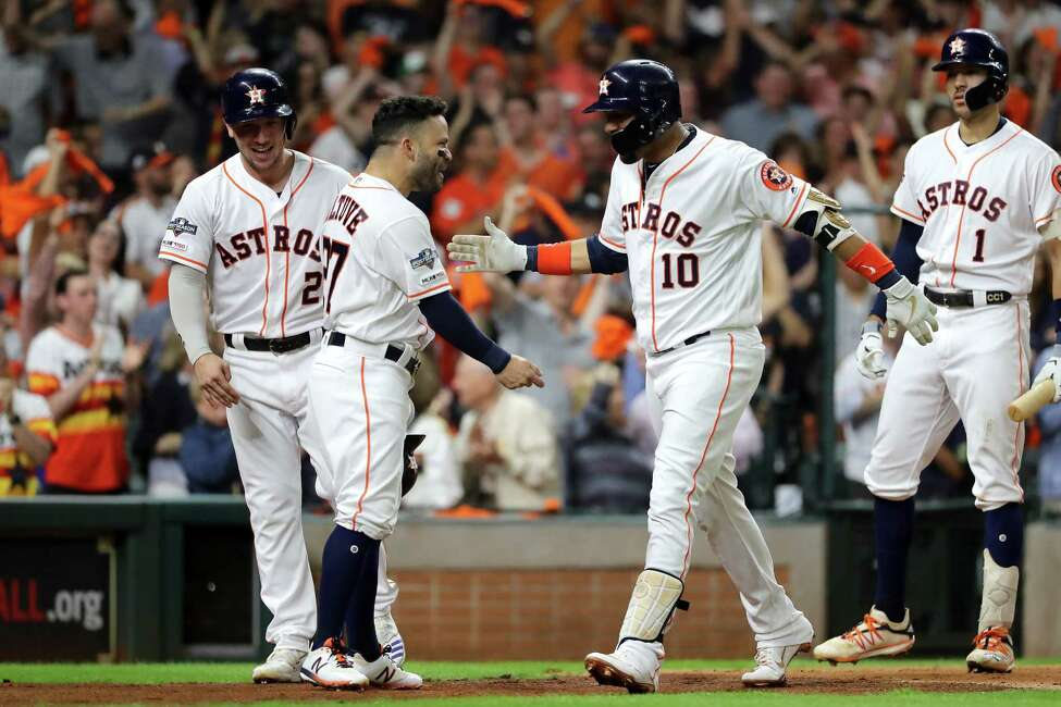 HOUSTON, TEXAS - OCTOBER 19: Yuli Gurriel #10 of the Houston Astros is congratulated by his teammate Jose Altuve #27 after his three-run home run against the New York Yankees during the first inning in game six of the American League Championship Series at Minute Maid Park on October 19, 2019 in Houston, Texas. (Photo by Elsa/Getty Images)