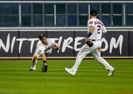 Houston Astros left fielder Michael Brantley (23) catches a line drive from New York Yankees center fielder Aaron Hicks (31) during the seventh inning of Game 6 of the American League Championship Series at Minute Maid Park in Houston on Saturday, Oct. 19, 2019. Brantley would proceed to throw out New York Yankees right fielder Aaron Judge (99) at first base to end the top of the inning.