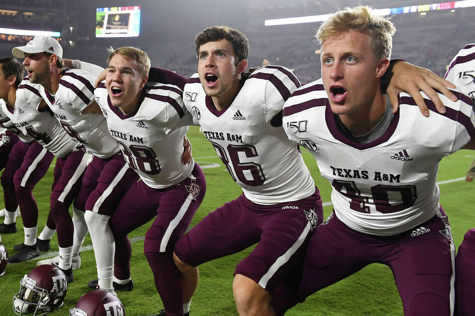 Texas A&M players celebrate after an NCAA college football game against Mississippi in Oxford, Miss., Saturday, Oct. 19, 2019. Texas A&M won 24-17. (AP Photo/Thomas Graning)