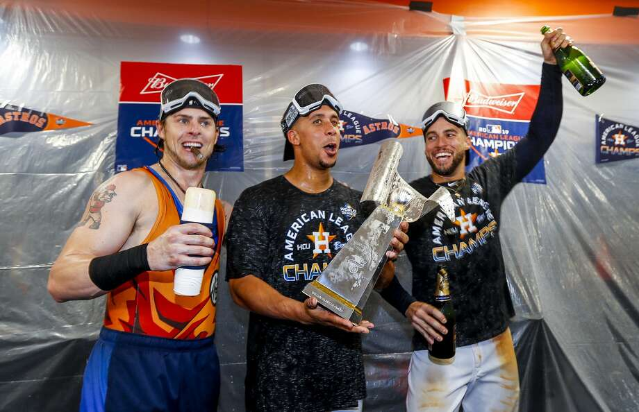 Houston Astros right fielder Josh Reddick (22), Houston Astros left fielder Michael Brantley (23) and Houston Astros center fielder George Springer (4) celebrate in the clubhouse after the Astros won the American League Championship Series at Minute Maid Park in Houston on Saturday, Oct. 19, 2019. Photo: Karen Warren/Staff Photographer