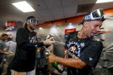 Houston Astros left fielder Michael Brantley (23) celebrates in the clubhouse after the Astros won the American League Championship Series at Minute Maid Park in Houston on Saturday, Oct. 19, 2019.