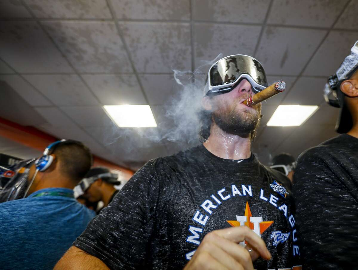 Houston Astros starting pitcher Gerrit Cole (45) celebrates in the clubhouse after the Astros won the American League Championship Series at Minute Maid Park in Houston on Saturday, Oct. 19, 2019.