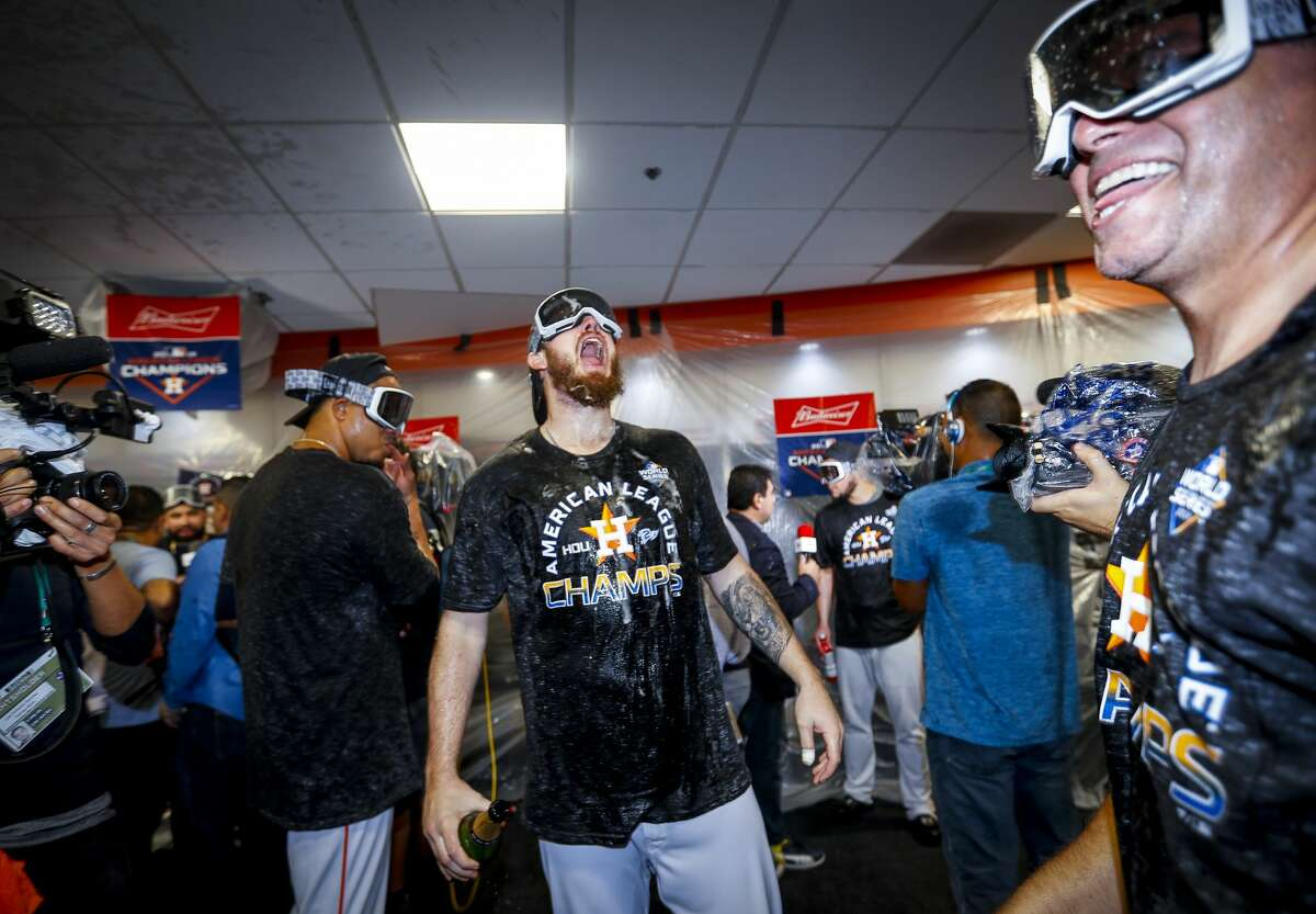 Myles Straw celebrates in the clubhouse after Game 6 of the American League Championship Series at Minute Maid Park in Houston on Sunday, Oct. 20, 2019.