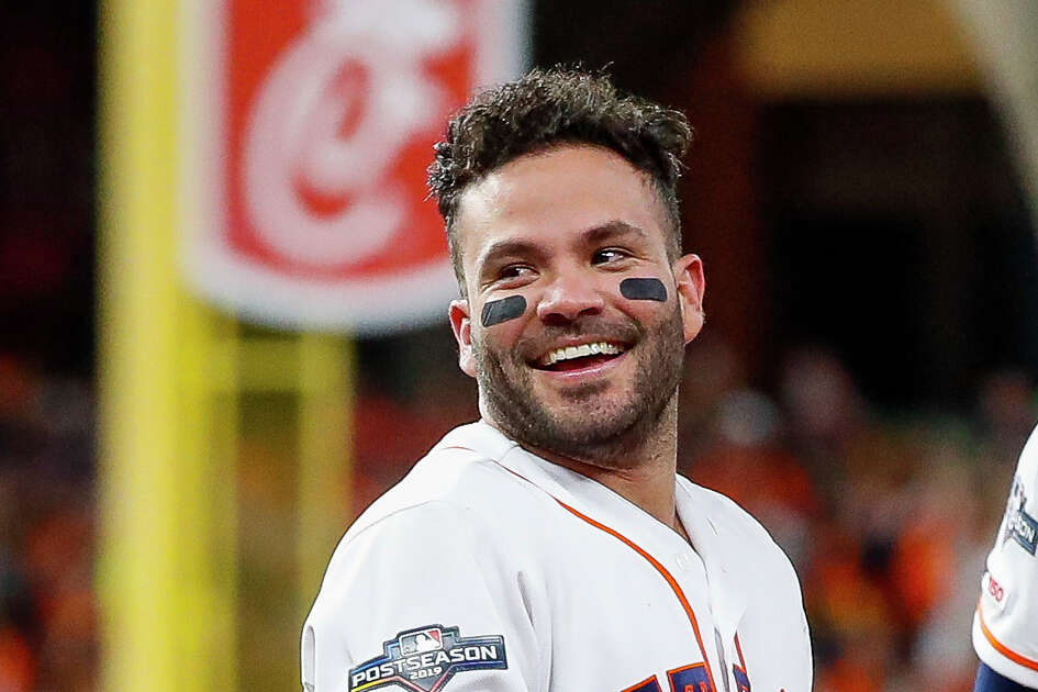 Houston Astros second baseman Jose Altuve (27) smiles after celebrating his series-winning, walk-off home run during Game 6 of the American League Championship Series at Minute Maid Park in Houston on Saturday, Oct. 19, 2019.
